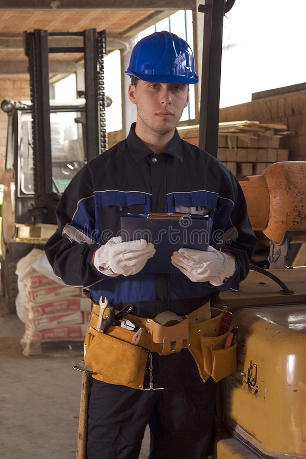 Construction workerer hold check list stock images