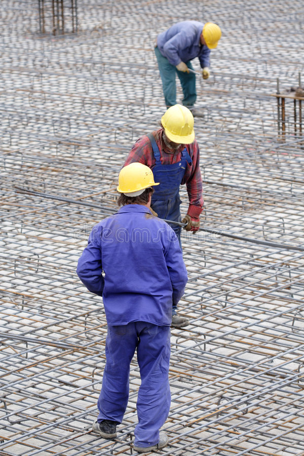 Construction workers. Three construction workers at work royalty free stock photography