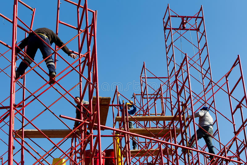 Construction workers building a new structure in city stock photo
