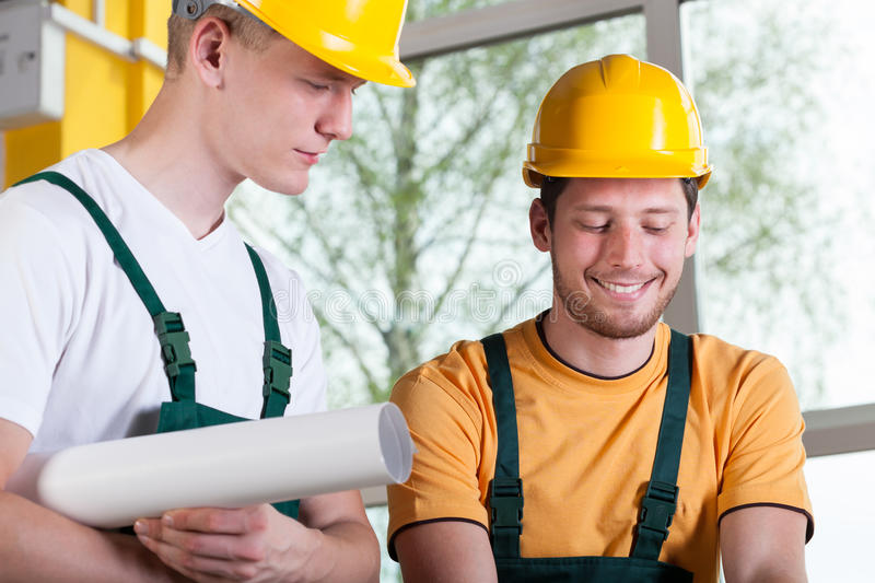 Construction workers discussing project stock photo