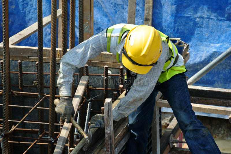 A construction workers fabricating pile cap formwork stock image