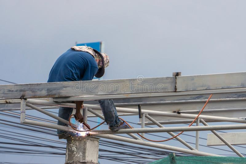 A construction workers installing beam formwork. Formwork is located at the high level stock image