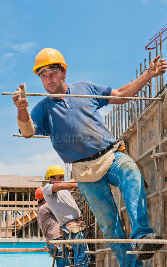 Construction workers installing formwork frames stock photos