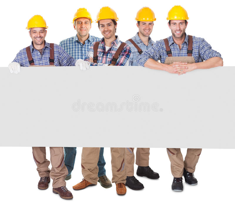 Construction workers presenting empty banner royalty free stock image