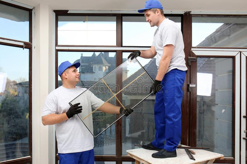 Construction workers repairing window royalty free stock photography