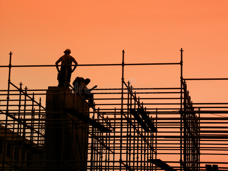 Construction workers on scaffolding stock image