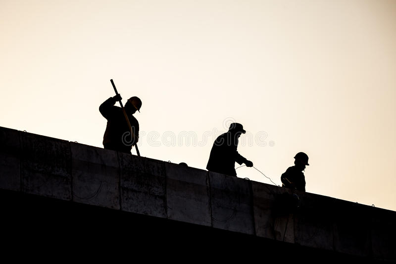 Construction workers silhouette stock images