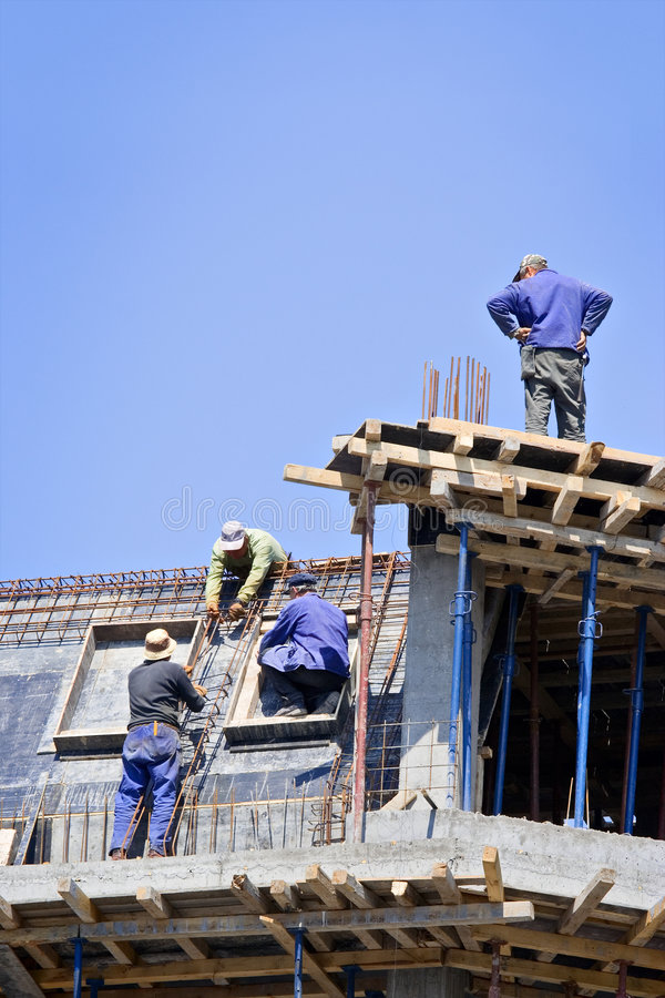 Construction workers at site stock photography