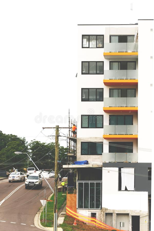 Construction Workers on site at 47 Beane St. Gosford. March, 2019. Building update ed220. Gosford, New South Wales, Australia - March 18, 2019: Workmen stock photos