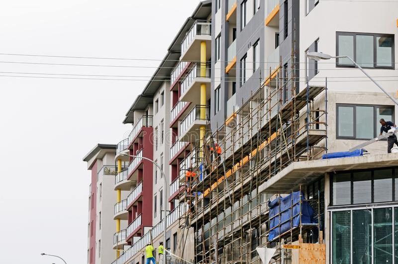 Construction Workers on site at 47 Beane St. Gosford. March, 2019. Building update ed221. Gosford, New South Wales, Australia - March 18, 2019: Workmen close up royalty free stock photography