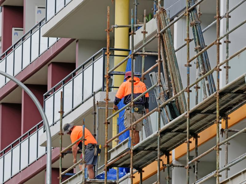 Construction Workers on site at 47 Beane St. Gosford. March, 2019. Building update ed223. Gosford, New South Wales, Australia - March 18, 2019: Workmen close up stock photography