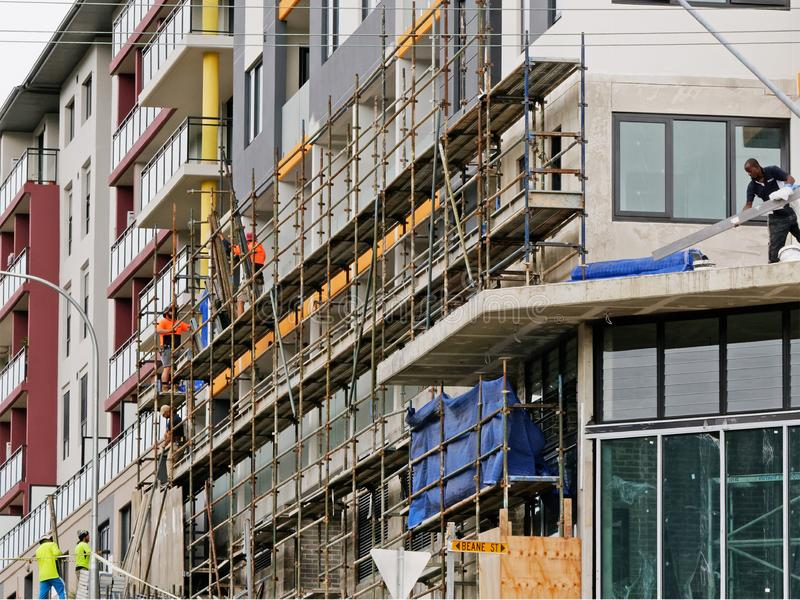 Construction Workers on site at 47 Beane St. Gosford. March, 2019. Building update ed224. Gosford, New South Wales, Australia - March 18, 2019: Workmen close up stock photos