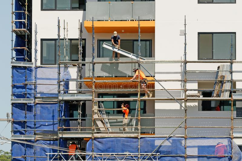 Construction Workers on site at 47 Beane St. Gosford. March, 2019. Building update 194. Gosford, New South Wales, Australia - March 4, 2019: Workers royalty free stock image