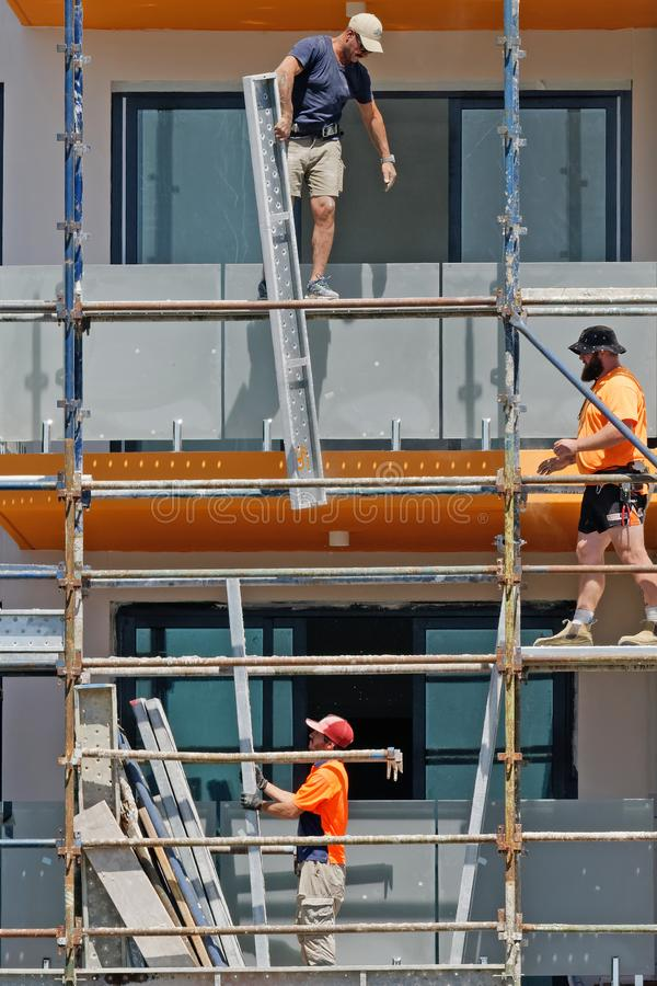 Construction Workers on site at 47 Beane St. Gosford. March, 2019. Building update 195. Gosford, New South Wales, Australia - March 4, 2019: Workmen close up stock photos