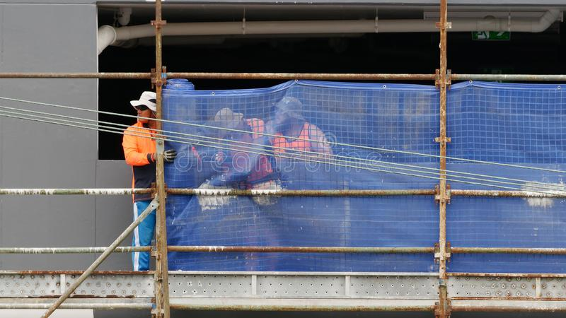 Construction Workers on site at 47 Beane St. Gosford. March, 2019. Building update 208. Gosford, New South Wales, Australia - March 6, 2019: Workmen close up stock image