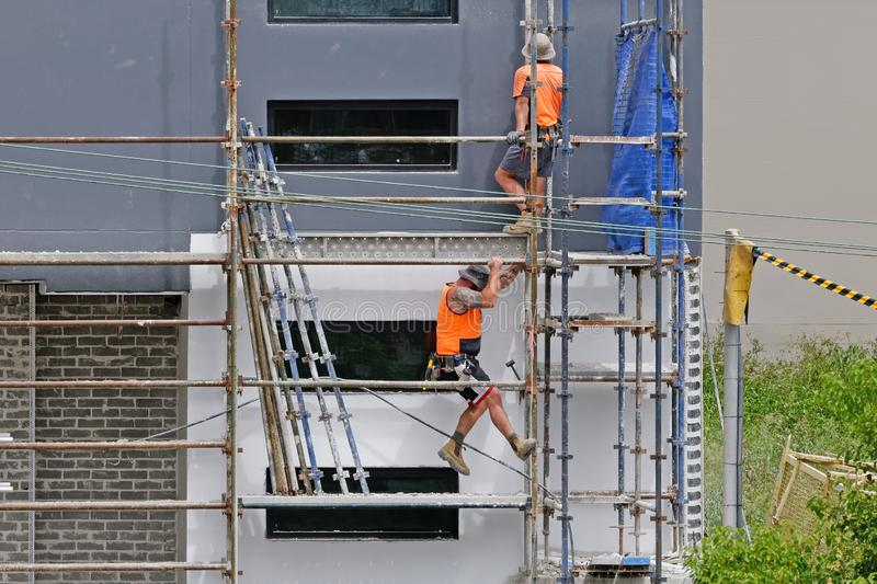 Construction Workers on site at 47 Beane St. Gosford. March, 2019. Building update 211. Gosford, New South Wales, Australia - March 6, 2019: Workmen close up royalty free stock photo