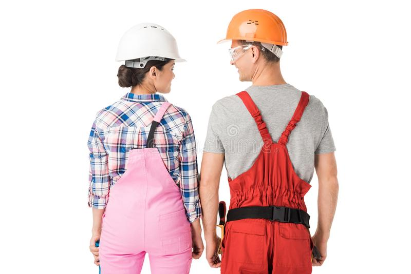 Construction workers team of man and woman in helmets royalty free stock photo