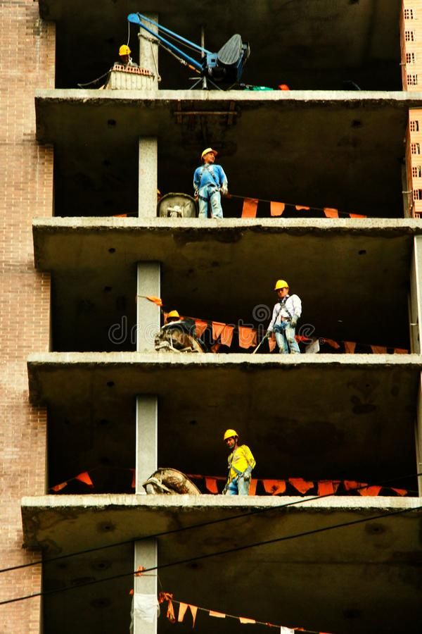 Construction workers at various heights royalty free stock photos