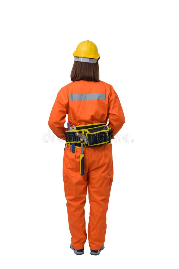 Construction workers wearing Orange Protective clothes, helmet with tool belt isolated on white backround. Back view of construction woman workers wearing Orange royalty free stock photography