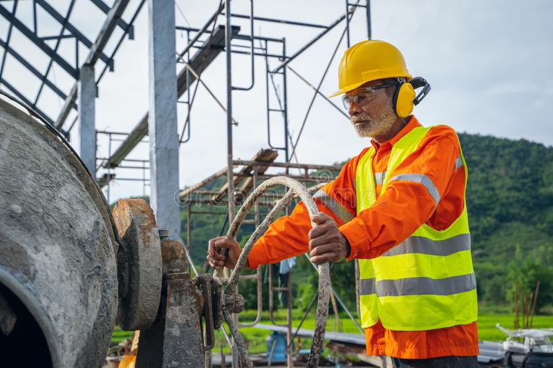 Construction workers wearing safety clothing worker On Building Site. stock photos