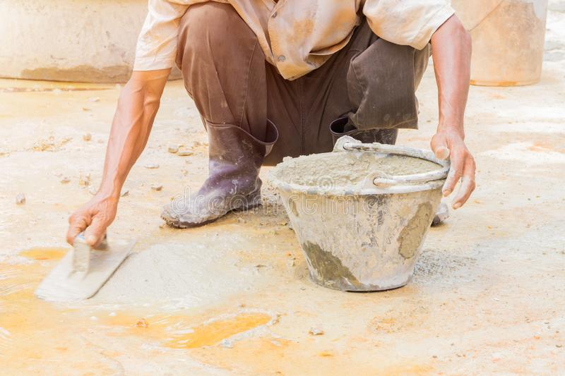 Construction workers were plastering repair floor in workplace build a house stock images