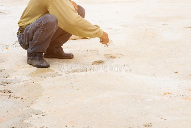 Construction workers were plastering repair floor in workplace build a house stock photography