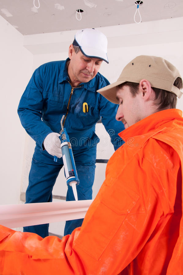 Construction workers at work. Two Construction workers at work royalty free stock photo