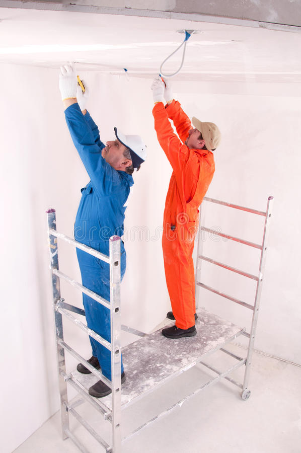 Construction workers at work. Two Construction workers at work royalty free stock photos