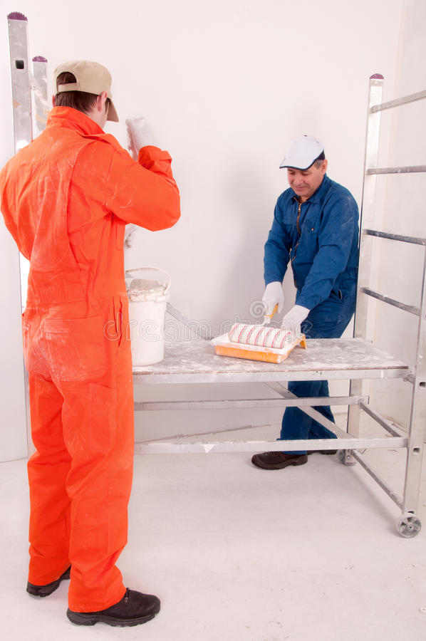Construction workers at work. Two Construction worker at work royalty free stock photo