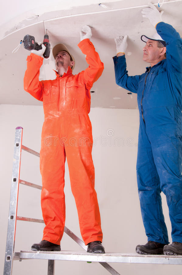 Construction workers at work. Two Construction workers at work stock photography