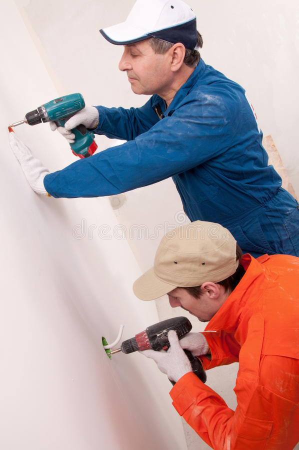 Construction workers at work. Two construction workers at work stock photo