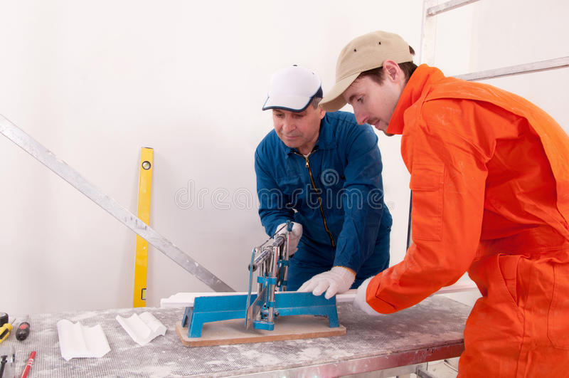 Construction workers at work. Two construction workers at work royalty free stock images