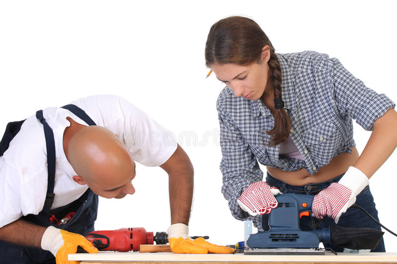 Construction workers at work. On white background stock photo