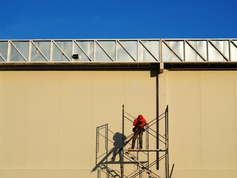 Construction workers working on scaffolding royalty free stock photography