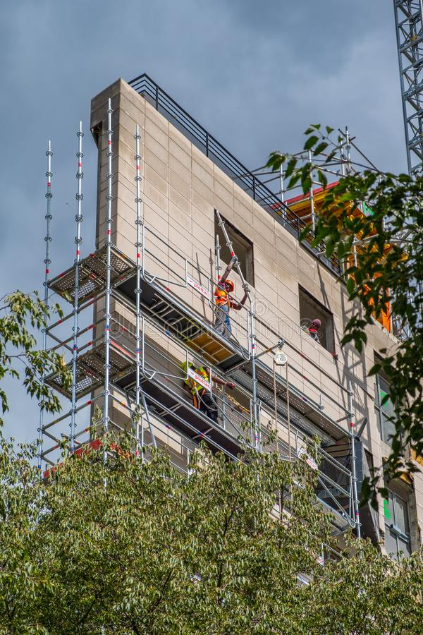 Construction workers working on scaffolding in a building in nor royalty free stock images