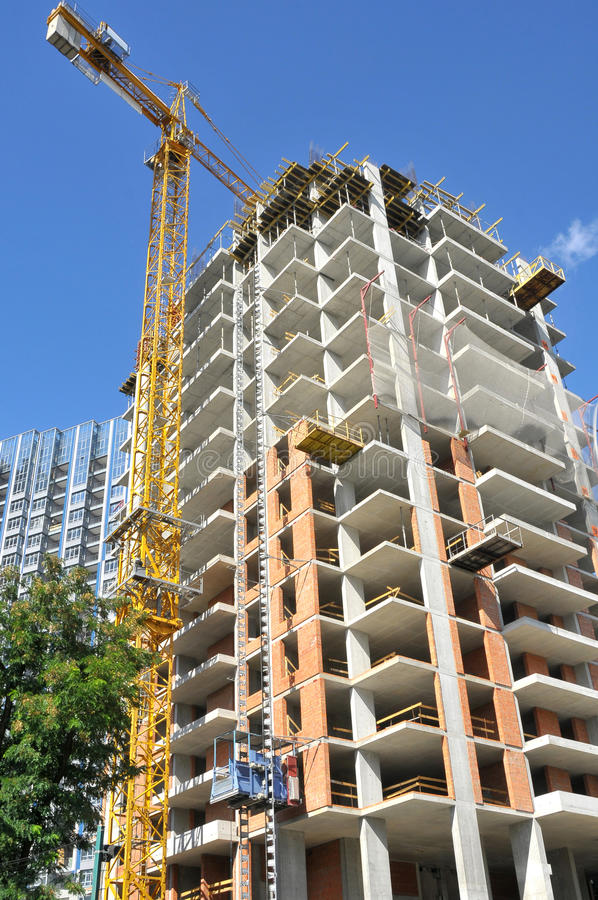 Construction works and high-rise building stock image