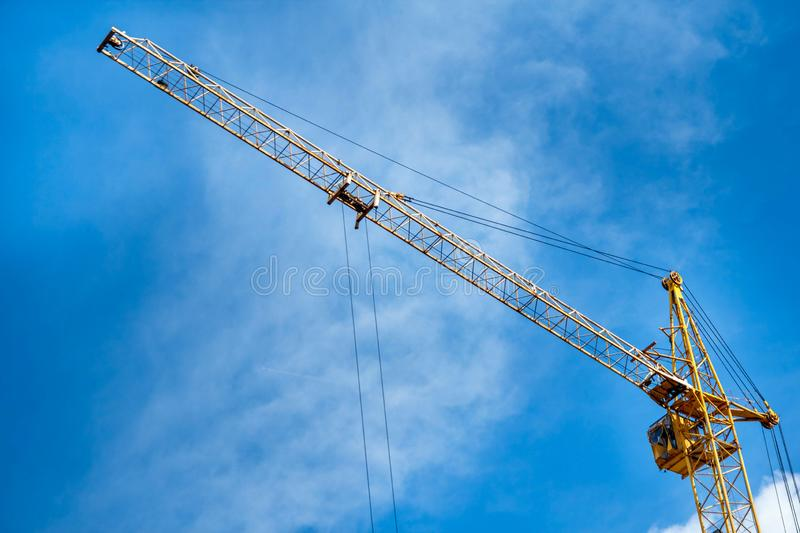 Construction yellow crane against the background of a blu sky.  royalty free stock images