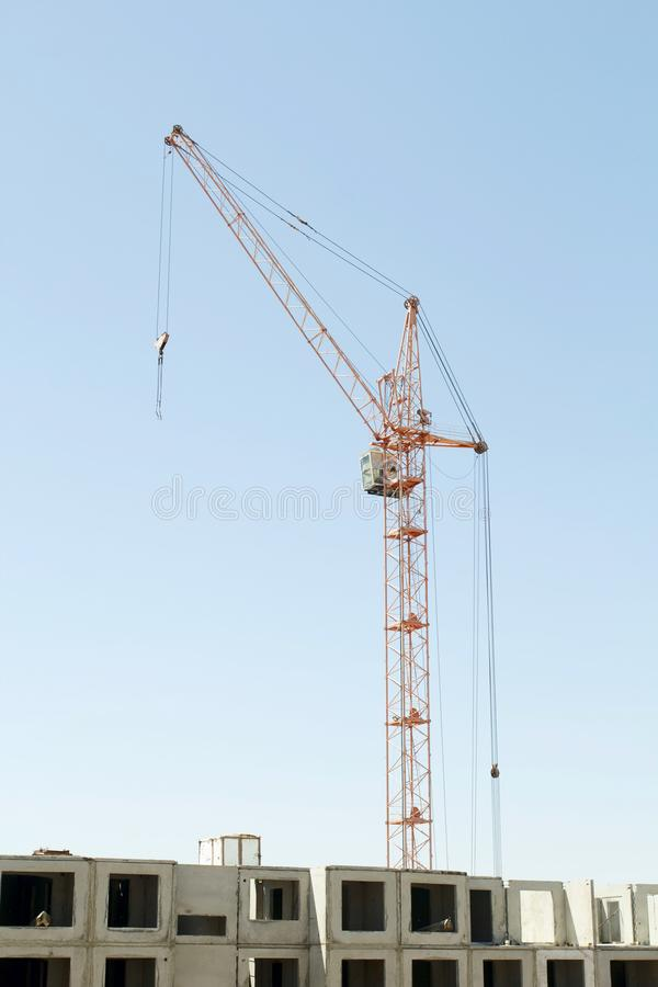 Constructions cranes near building. Construction site with crane and building. royalty free stock photos