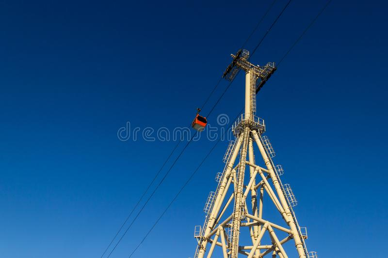 Constructions of Ski lift towers. Against the blue sky stock photo