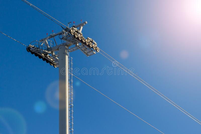 Constructions of Ski lift towers. & cableways against the blue sky royalty free stock photos