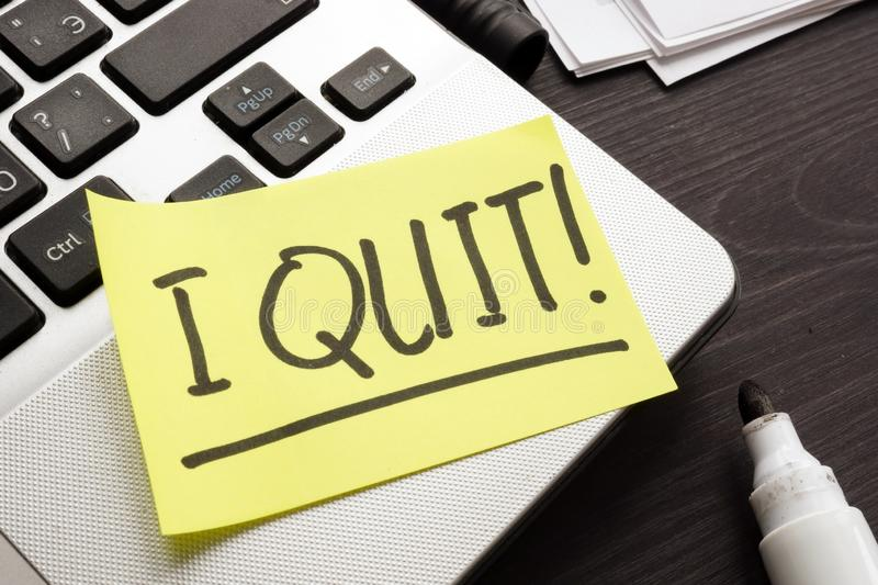 Constructive dismissal. Piece of paper with words I quit job royalty free stock images