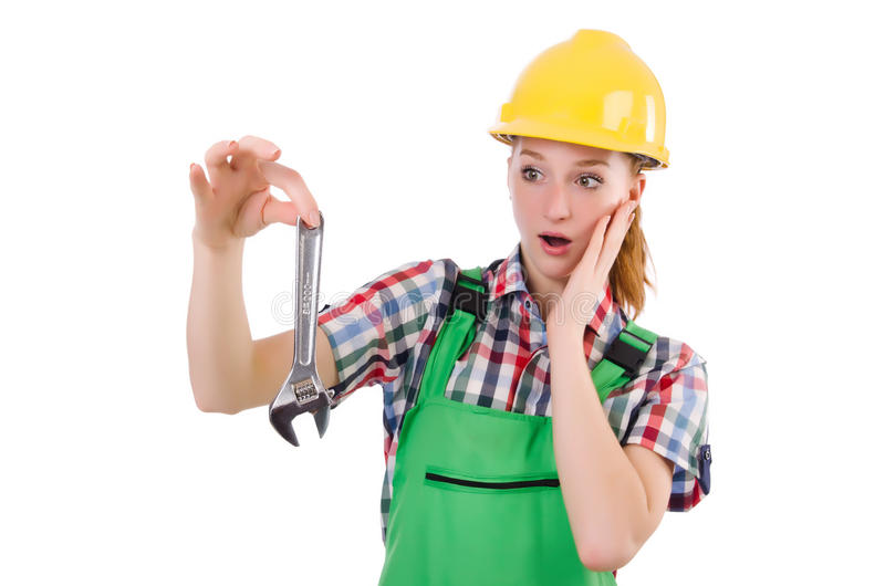 Constructon worker female with wrench. Isolated on white stock images