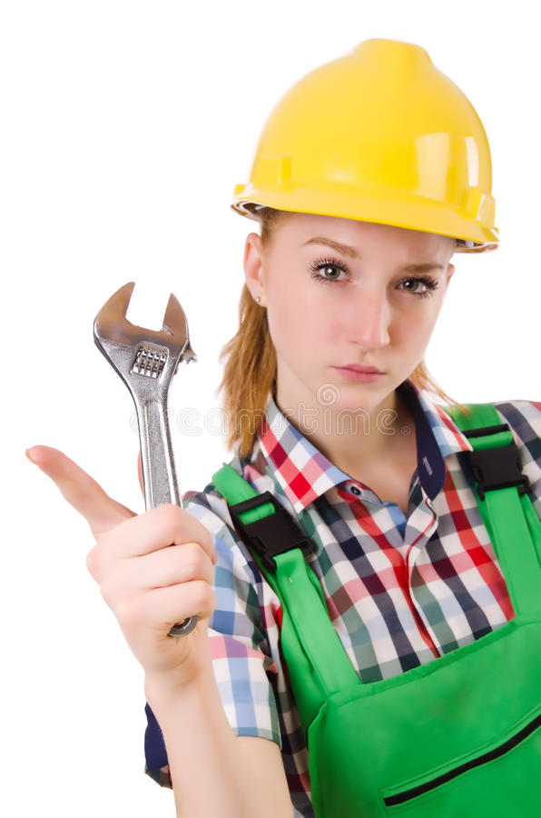 Constructon worker female with wrench. Isolated on white stock image