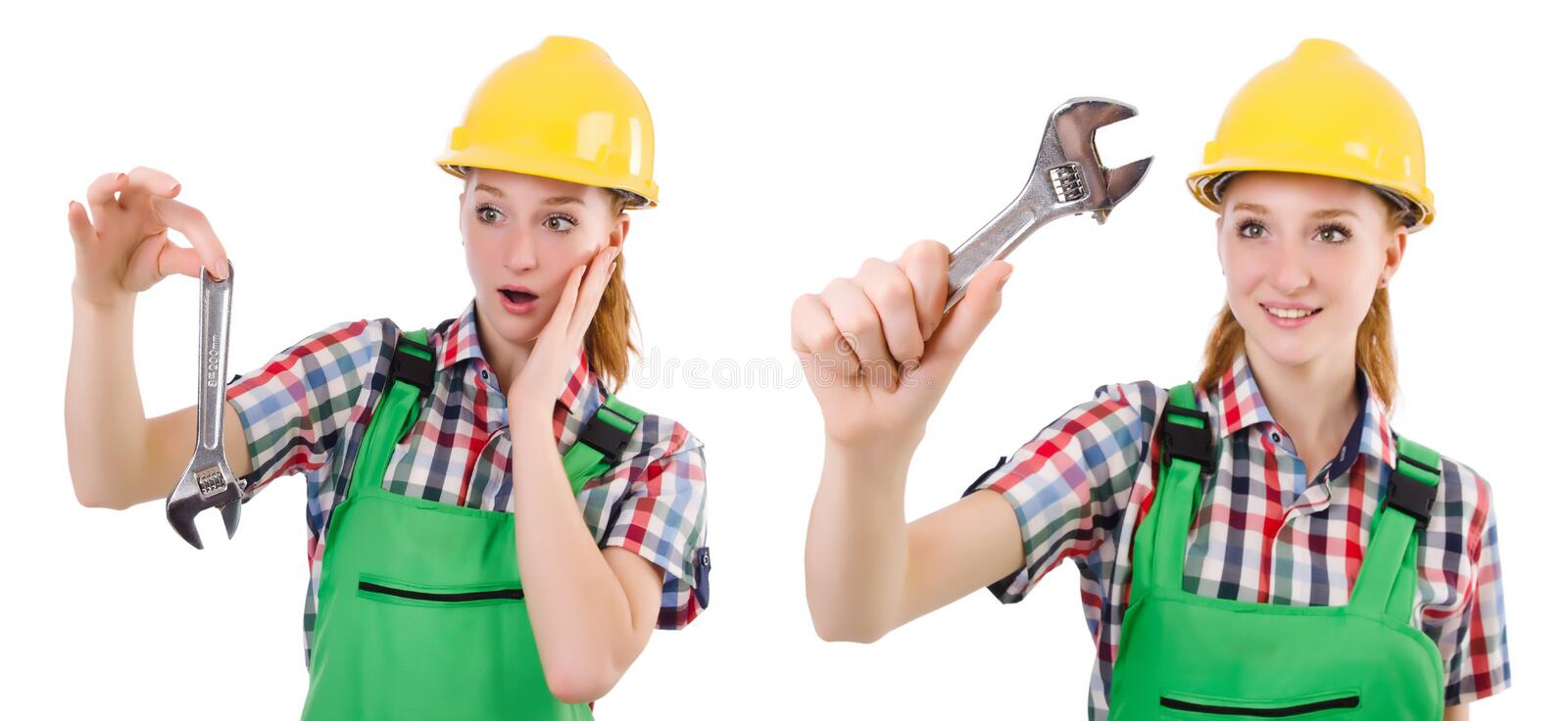 The constructon worker female with wrench isolated on white. Constructon worker female with wrench isolated on white royalty free stock image