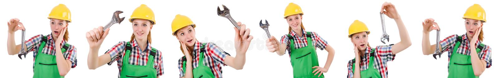 The constructon worker female with wrench isolated on white. Constructon worker female with wrench isolated on white royalty free stock images