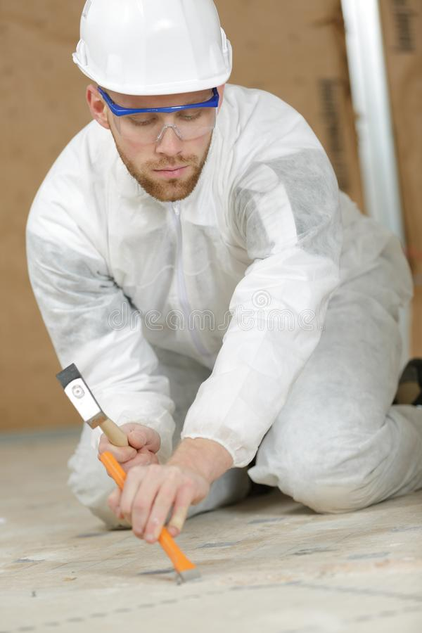 Constructon worker using hammer and chisel royalty free stock images