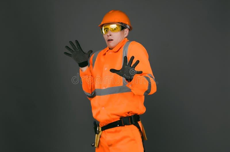 Constructor asustado fotos de archivo