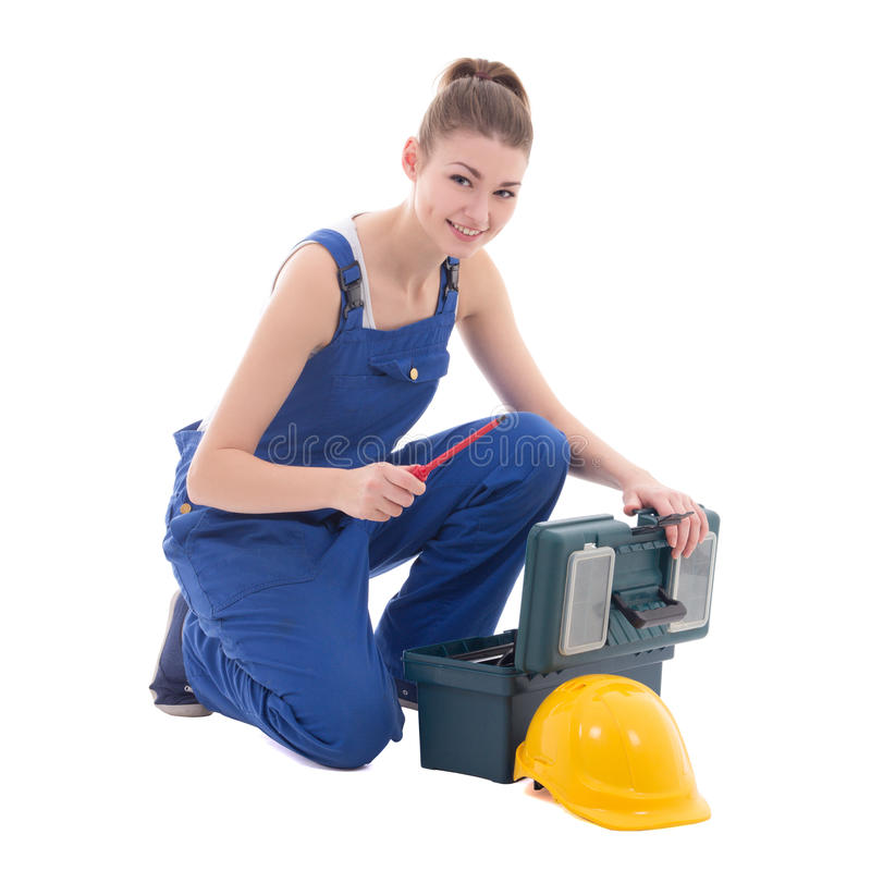 Constructor atractivo joven de la mujer en workwear con la caja de herramientas aislada fotos de archivo libres de regalías