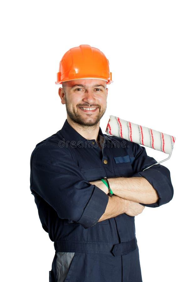 Constructor con el rodillo para pintar aislado en el fondo blanco foto de archivo