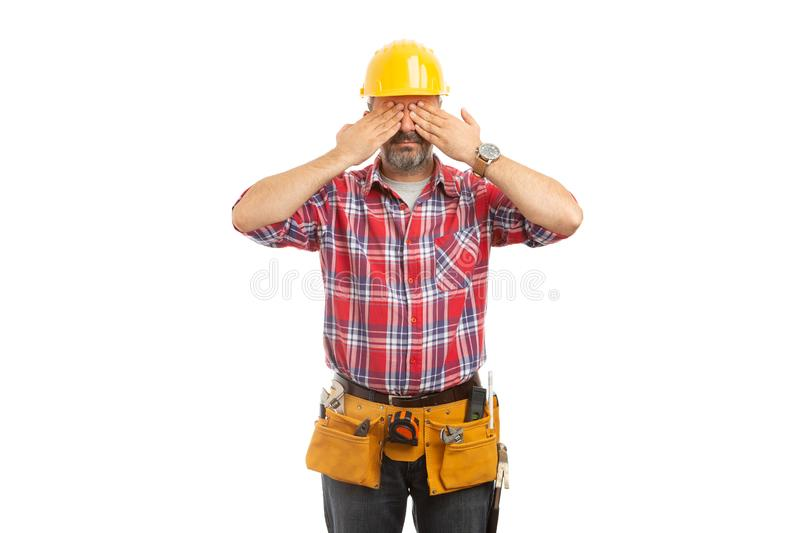 Constructor covering eyes stock photo